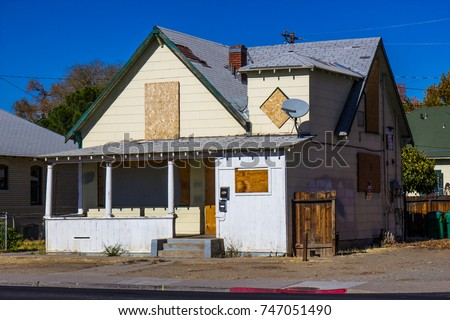 old boarded up home lost to...
