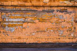 Old boards with cracked rusty paint. Textured wooden old background with vertical lines