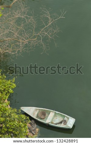 Old boat beside the pond, view from top