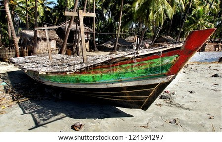 old boat in asia is used to dry fish in the sun