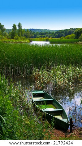Old boat on a pond - stock photo