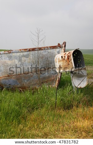 old boat on land with mailbox