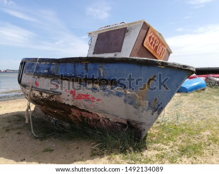Old boat stranded on beach