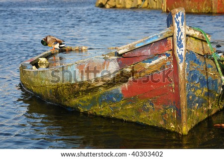 old boat with duck