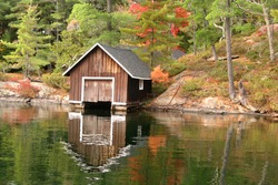 Old boathouse by a lake in Autumn