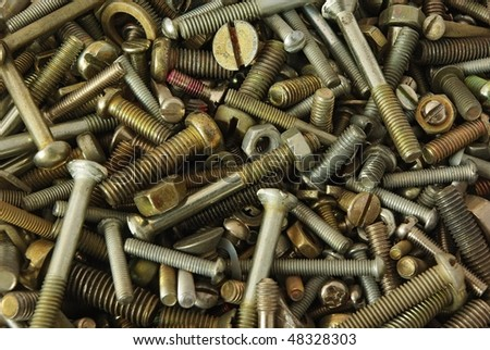 Old bolts,screws,nuts and pucks as background