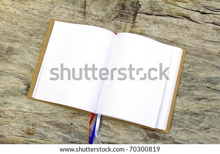 Old book (Ancient book) on wood wall