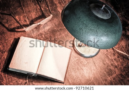 Old book and electric lamp in retro style