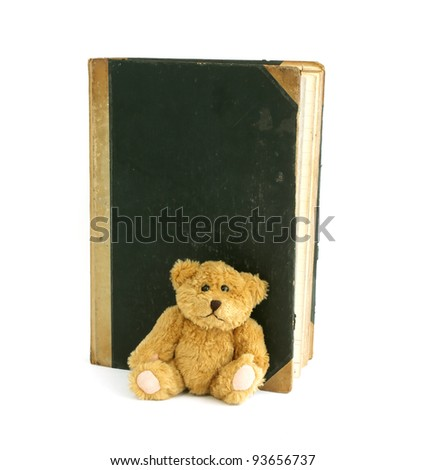 old book and old bear isolated on white background