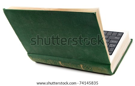 Old book as laptop with computer keyboard isolated on white