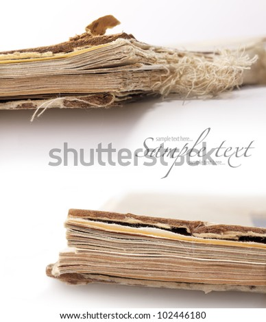 Old book on white background, detail, closeup (with sample text)