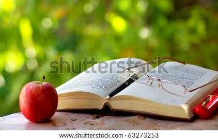 Old book, pen  and glasses. - stock photo