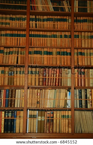 old book shelves in ancient library - stock photo
