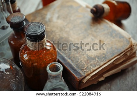old book with glass bottles ...