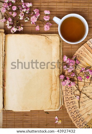 Old book with green tea