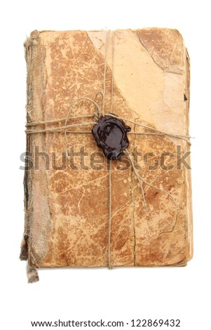 Old book with seal wax, isolated on white
