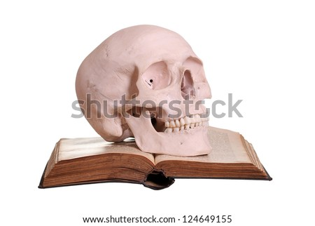 old book with skull - stock photo