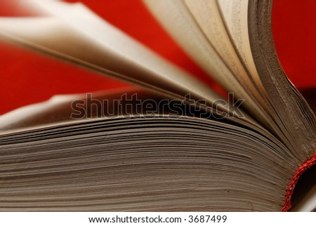 Old book with turning pages as a symbol of wisdom and knowledge