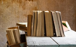 old books abandoned on an old wooden table
