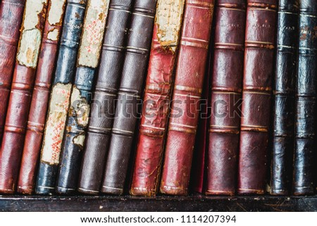 Old books, ancient put on the shelves, decorated in the home , soft focus. #1114207394