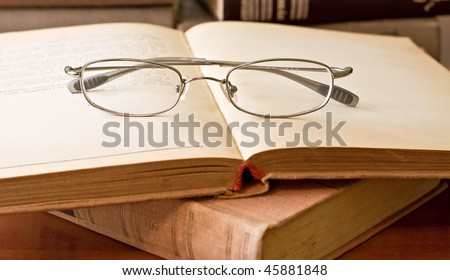 Old books and glasses. Vintage style