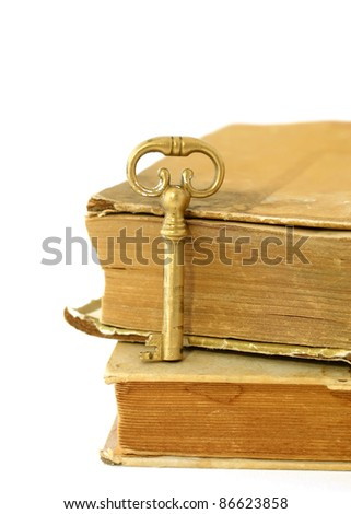old books and old key isolated on white background
