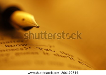 Old Books and Pen , shot with very shallow depth of field, Gold tone