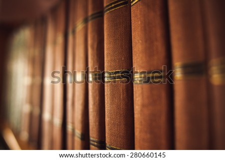 old books in a old library on the bookshelf