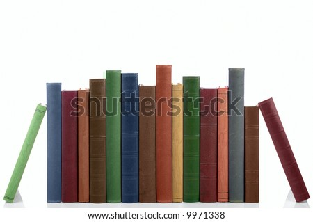 Old books in a row all hardbacks some with leather covers Isolated on white with slight shadow