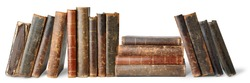 Old books in a row isolated on white background