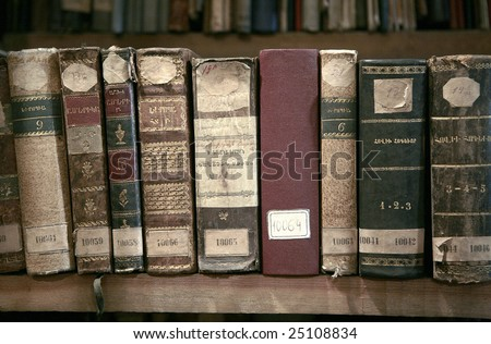 Old books in the library bookshelf