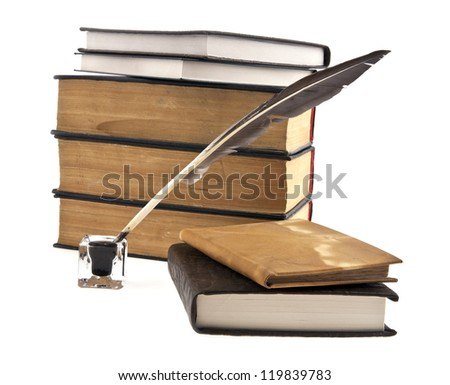 old books, ink-pot and feather on a white background