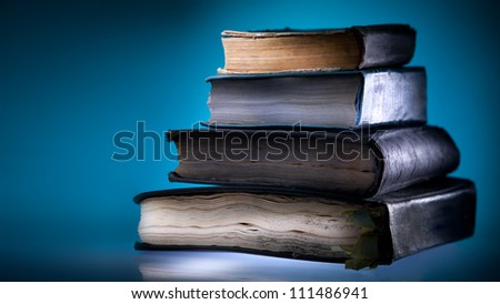Old books, mystical blue light  background