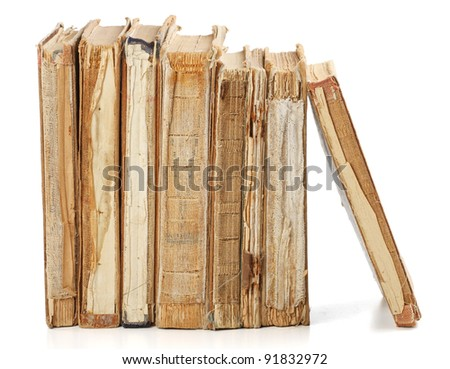 Old books of different shape and color. Isolated on white background.