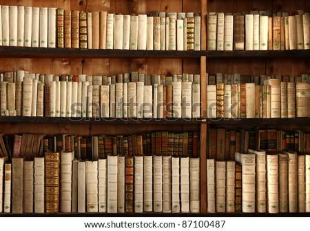 old books on a shelf - stock photo