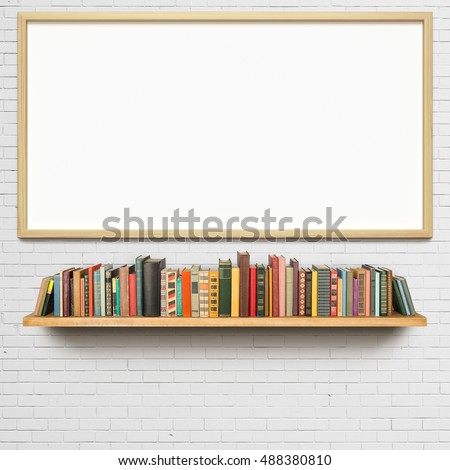 Old books on the shelf and blank picture frame