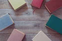 Old books on wooden background. View from above