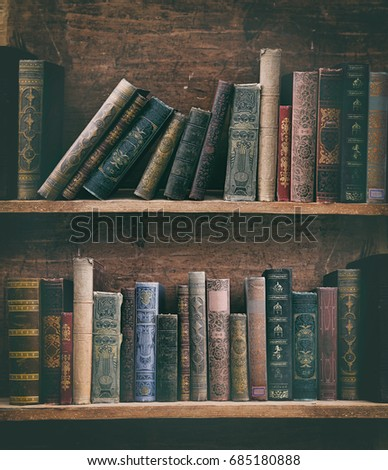 old books on wooden shelf.