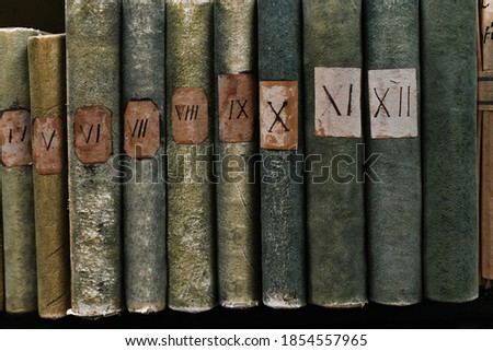 Old books with Roman numerals in the library Stock photo ©