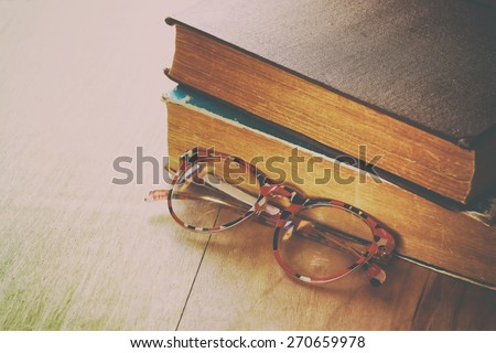 old books with vintage glasses...