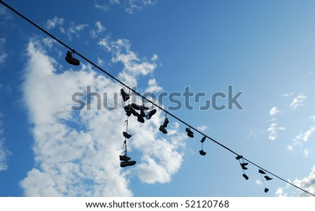 old boots hanging on the rope