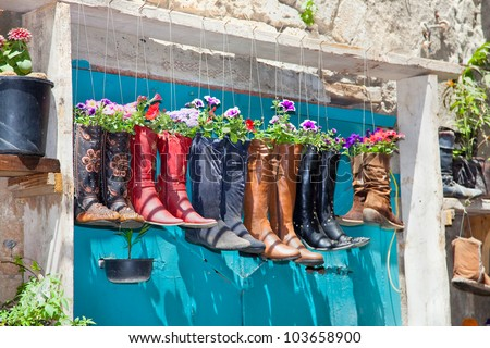 old boots used as flower pots...