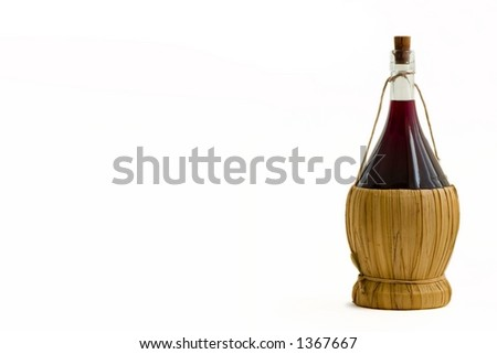Old bottle of red wine on a white background