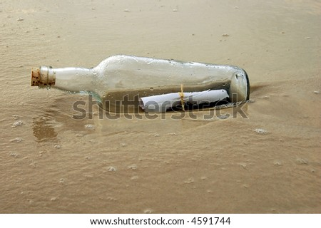 Old Bottle with message on shore of beach