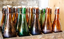 old bottles in wooden boxes