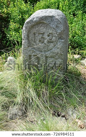 old boundary stone  #726984511