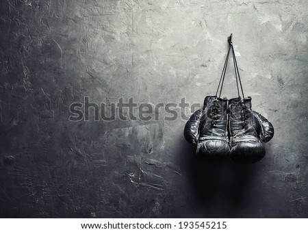 old boxing gloves hang on nail...