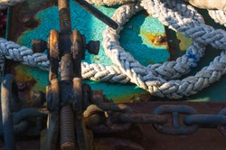 Old braided rope on the wooden deck of a sea boat