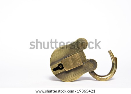 old brass padlock isolated on a white background.