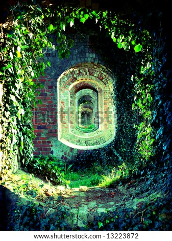 Old brick archways covered in natural foliage. - stock photo